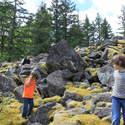 kids on mossy boulder slope